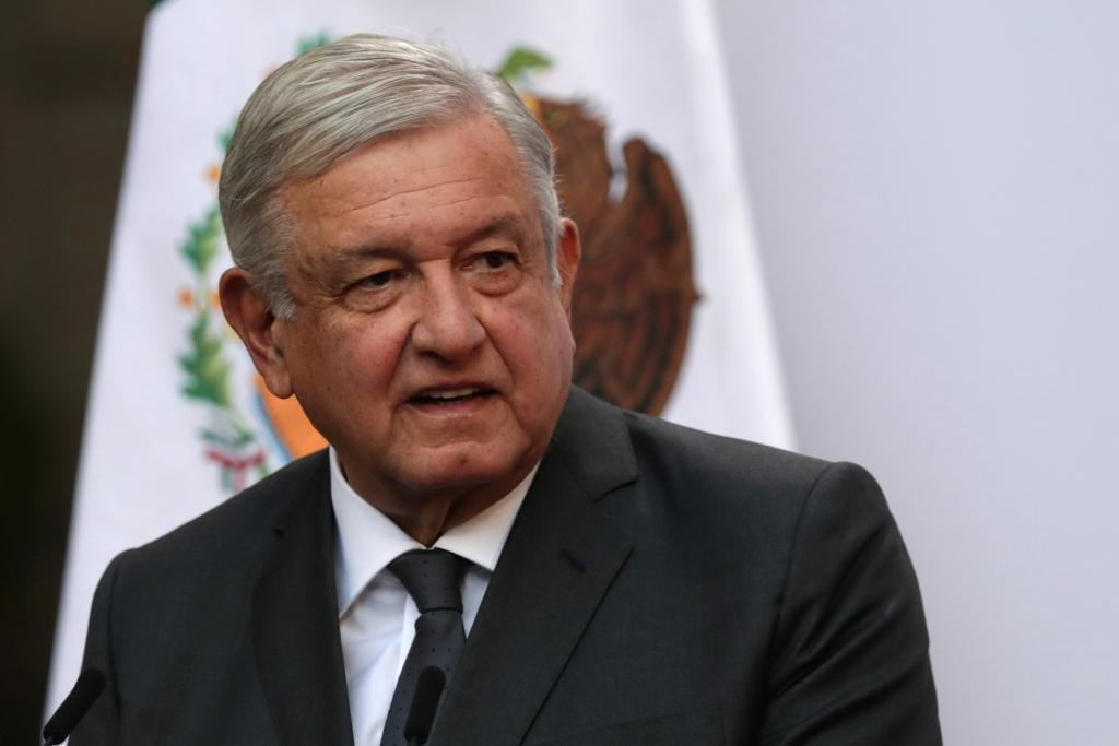 Mexico's President Andres Manuel Lopez Obrador addresses to the nation on his second anniversary as the President of Mexico, at the National Palace in Mexico City, Mexico, December 1, 2020. Mexican President Andres Manuel Lopez Obrador has tested positive for COVID-19, he said on Sunday, adding that his symptoms were light and that he was receiving medical treatment. Photo taken December 1, 2020. REUTERS/Henry Romero